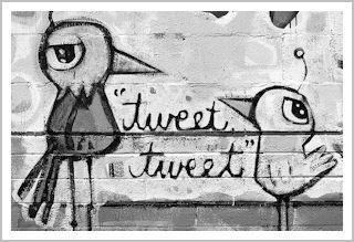 Mural showing two birds tweeting